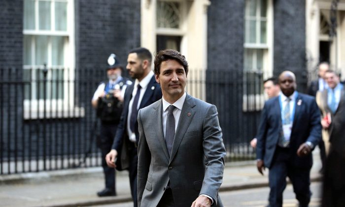 Prime Minister Justin Trudeau leaves Downing Street after bilateral talks with Prime Minister Theresa May, in London on April 18, 2018. (Jack Taylor/Pool Photo via AP)