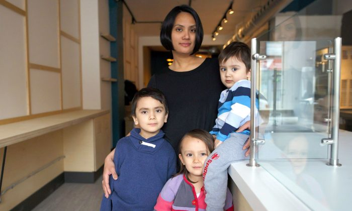 Toronto mom Pauline Osena with her boys Lucien, 6, and Xavier, 2, both of whom have severe food allergies, and her daughter Anika, 4, on April 17, 2018. (The Canadian Press/Cole Burston)