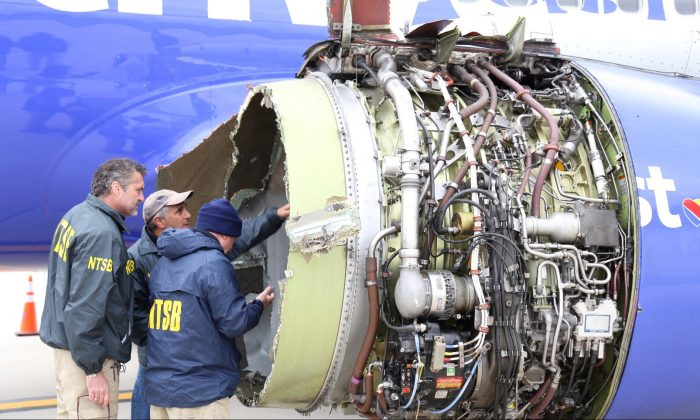 U.S. NTSB investigators are on scene examining damage to the engine of the Southwest Airlines plane in this image released from Philadelphia, Pennsylvania, U.S., April 17, 2018. (NTSB/Handout via Reuters)