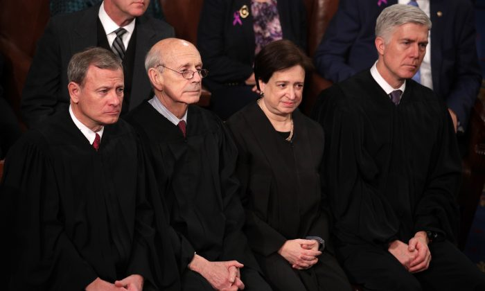 (L-R) U.S. Supreme Court Justices John G. Roberts, Stephen G. Breyer, Elena Kagan, and Neil M. Gorsuch attend the State of the Union address in Washington D.C. on Jan. 30, 2018. (Alex Wong/Getty Images)