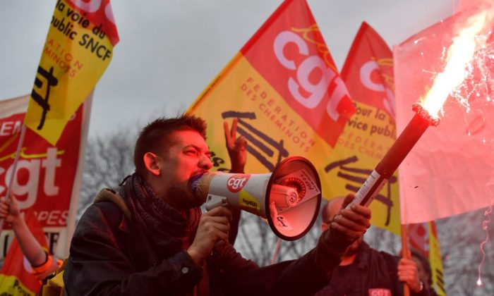 SNCF railway workers demonstrate, on April 9, 2018 in Paris, as part of their strike over plans to overhaul the national state-owned railway company SNCF. (Gerard Julien/AFP/Getty Images)