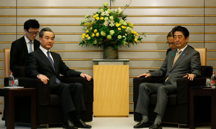 China's Foreign Minister Wang Yi (L) meets with Japan's Prime Minister Shinzo Abe at Abe's official residence in Tokyo on April 16, 2018. (Toru Hanai/AFP/Getty Images)