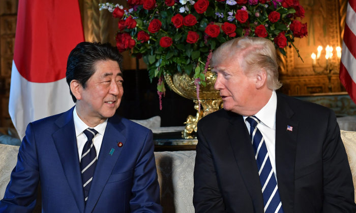 President Donald Trump greets Japanese Prime Minister Shinzo Abe as he arrives for talks at Trump's Mar-a-Lago resort in Palm Beach, Florida, on April 17, 2018. (MANDEL NGAN/AFP/Getty Images)