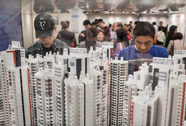 Applicants are  looking at the housing models in the application center in Kof Fu, Kowloon, Hong Kong on April 11, 2018. 