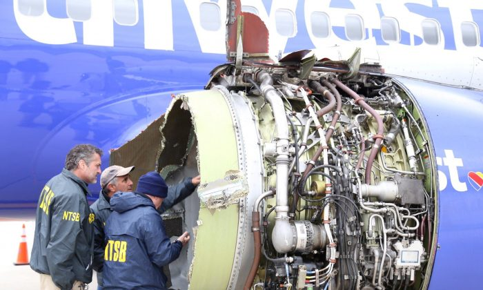 A U.S. NTSB investigator is on scene examining damage to the engine of the Southwest Airlines plane in this image released from Philadelphia, Pennsylvania, U.S., April 17, 2018. (NTSB/Handout via Reuters)
