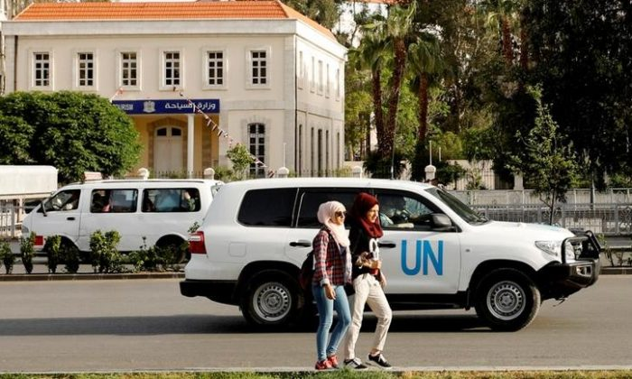The United Nation vehicle carrying the Organisation for the Prohibition of Chemical Weapons (OPCW) inspectors is seen in Damascus, Syria April 17, 2018. (Reuters/Omar Sanadiki)