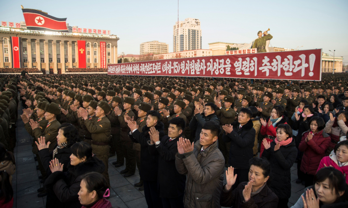 North Koreans attend a mass rally to celebrate the North's declaration on November 29 it had achieved full nuclear statehood, on Kim Il-Sung Square in Pyongyang on December 1, 2017. (KIM WON-JIN/AFP/Getty Images)