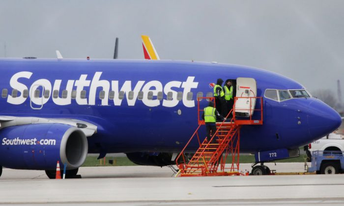 A Southwest Airlines jet sits on the runway at Philadelphia International Airport after it was forced to land with an engine failure, in Philadelphia, Pennsylvania, on April 17, 2018. (DominickReuter/AFP/Getty Images)