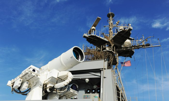 The U.S. Navy Afloat Forward Staging Base USS Ponce (AFSB(I)-15) conducts an operational demonstration of the Office of Naval Research (ONR)-sponsored Laser Weapon System (LaWS) while deployed to the Arabian Gulf. (JOHN F. WILLIAMS/U.S. NAVY)