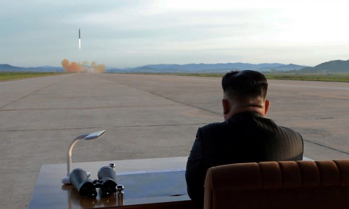 North Korean leader Kim Jong Un watches the launch of a Hwasong-12 missile in this undated photo released by North Korea's Korean Central News Agency (KCNA) on Sep. 16, 2017. (KCNA via REUTERS)
