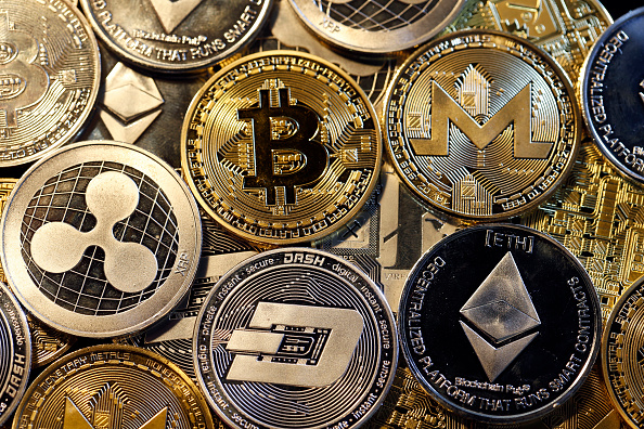 In this photo illustration, a visual representation of digital cryptocurrencies, Bitcoin, Ripple, Ethernum, Dash, Monero and Litecoin is displayed on Feb. 16, 2018 in Paris, France. Digital cryptocurrencies have seen unprecedented growth in 2017, despite remaining extremely volatile.  (Photo Illustration by Chesnot/Getty Images)