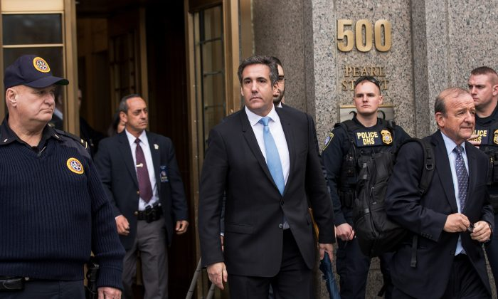 Michael Cohen (C), longtime personal lawyer and confidante for President Donald Trump, exits the United States District Court Southern District of New York, April 16, 2018 in New York City, after a hearing regarding the FBI's raid on Cohen's home, office, and hotel room (Drew Angerer/Getty Images)