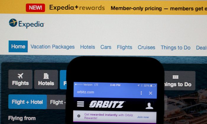 In this photo illustration, the website for Expedia Inc. and Orbitz Worldwide Inc. are seen next to each other on Feb. 12, 2015 in Miami, Florida.  Expedia annouced plans to purchase Orbitz for about 1.34 billiion dollars.  (Photo Illustration by Joe Raedle/Getty Images)