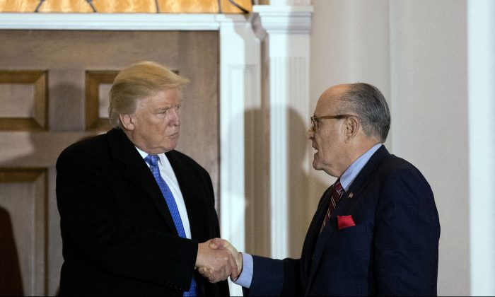 President-elect Donald Trump and former New York City mayor Rudy Giuliani shake hands following their meeting at Trump International Golf Club, November 20, 2016 in Bedminster Township, New Jersey. Trump and his transition team are in the process of filling cabinet and other high level positions for the new administration. (Photo by Drew Angerer/Getty Images)