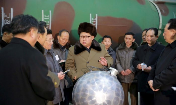 FILE PHOTO: North Korean leader Kim Jong Un meets scientists and technicians in the field of researches into nuclear weapons in this undated photo released by North Korea's Korean Central News Agency (KCNA) in Pyongyang March 9, 2016. REUTERS/KCNA/File Photo