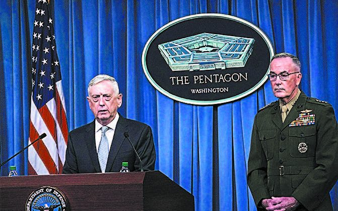 Defense Secretary Gen. Jim Mattis (L) and Gen. Joe Dunford, chairman of the Joint Chiefs of Staff, brief members of the media following airstrikes on Syria, at the Pentagon on April 13. (ALEX WONG/GETTY IMAGES)