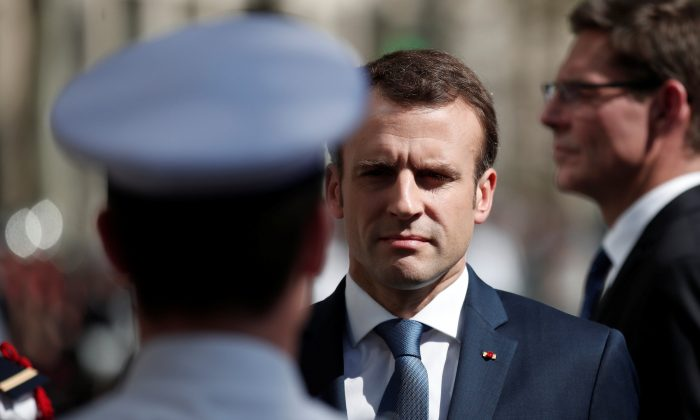 French President Emmanuel Macron attends a ceremony to pay tribute to Xavier Jugele one year after the French police officer was killed during a shooting incident, on the Champs Elysees avenue in Paris, France, April 20, 2018. (Reuters/Benoit Tessier/Pool)