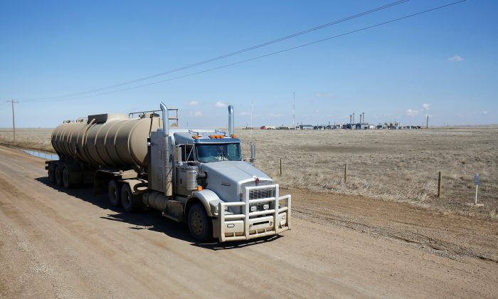 A tanker truck used to haul oil products drives away from an oil facility near Brooks, Alberta, Canada April 18, 2018.  (Reuters/Todd Korol)