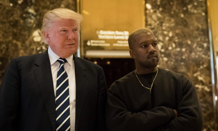 President-elect Donald Trump and Kanye West stand together in the lobby at Trump Tower in New York City on Dec. 13, 2016. (Drew Angerer/Getty Images)