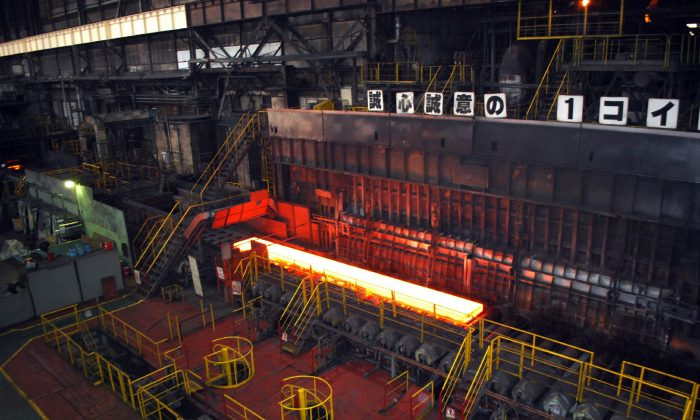 A rolling process of Nippon Steel's Kimitsu iron mill plant in suburban Tokyo on Nov. 26, 2010. Tariffs placed by the Trump administration on Japanese steel have created tension in the U.S.-Japan relationship. (JIJI PRESS/AFP/Getty Images)