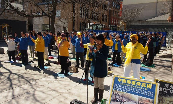 Falun Gong practitioners commemorate a peaceful appeal for freedom of belief that took place on April 25, 1999, in Beijing, China, at a gathering to raise awareness of the ongoing 19-year persecution of their faith by the Chinese regime, in Montreal's Chinatown on April 21, 2018. (Yi Ke/The Epoch Times)