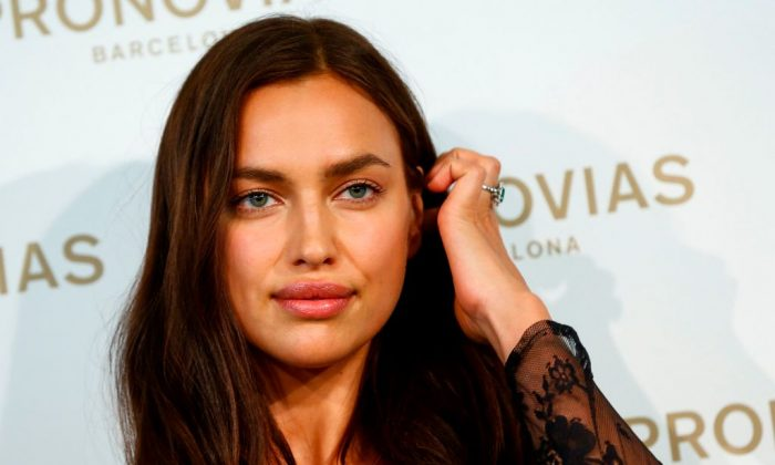 Russian model Irina Shayk presents a creation of the Pronovias 2019 collection ahead of the Barcelona Bridal Week at the brand's headquarters in Prat del Llobregat, on April 22, 2018.     (Photo credit should read PAU BARRENA/AFP/Getty Images)