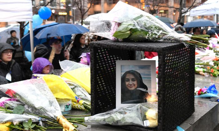 A photo of Anne Marie D'Amico at a memorial on Yonge Street in Toronto on April 24, 2018. D'Amico was one of those killed in the  attack in which a van struck pedestrians along a stretch of Yonge Street on April 23. (The Canadian Press/Galit Rodan)
