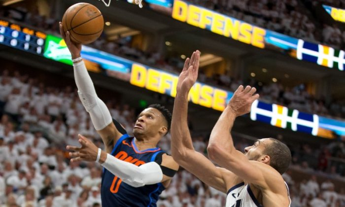 Oklahoma City Thunder guard Russell Westbrook (0) goes up for a shot against Utah Jazz center Rudy Gobert (27) during the first quarter of game four of the first round of the 2018 NBA Playoffs at Vivint Smart Home Arena. (Russ Isabella-USA TODAY Sports)