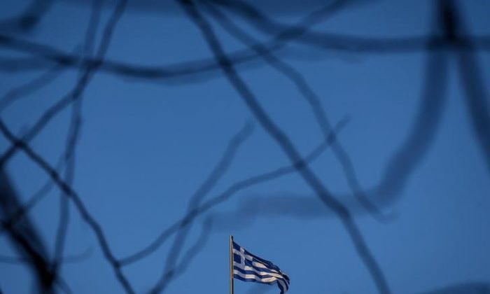 A Greek national flag flutters on the roof of a building in Athens, Greece Feb. 8, 2018. (REUTERS/Costas Baltas)