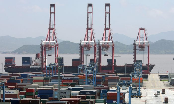 The Ningbo Port, a major storage and transshipment base for crude oil, iron ore, containers, and liquid chemical products, in Ningbo City, Zhejiang Province, China, on June 9, 2005. (Guang Niu/Getty Images)
