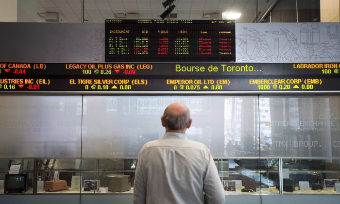 A man watches the financial markets at the TMX Group in Toronto's financial district in this file photo. (The Canadian Press/Darren Calabrese)