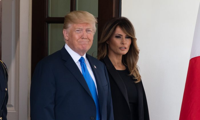 President Donald Trump and First Lady Melania Trump wait for the arrival of  President of France Emmanuel Macron and his wife Brigitte Macron at the White House in Washington on April 23, 2018. (Samira Bouaou/The Epoch Times)
