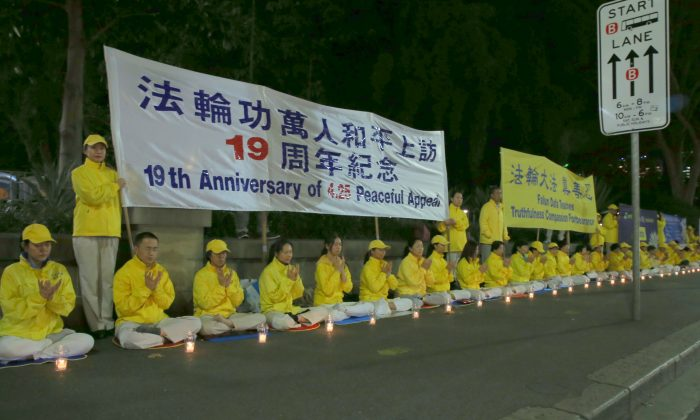 Falun Gong practitioners in Sydney, Australia, gather in a candlelight vigil to continue their journey of peaceful appeal for freedom of belief in China. (Linda Zhang/The Epoch Times)