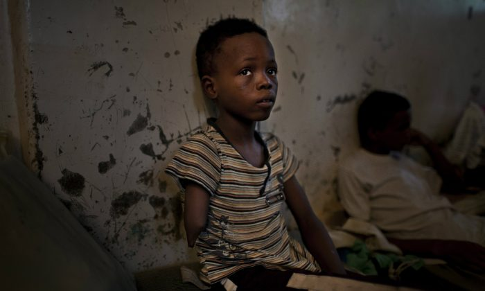 An eight year old amputee Nigerian boy locked up in Hodeidah Central Prison, Hodeidah, Yemen, Aug. 12, 2010. It's likely this boy is a child trafficking victim who has been deliberately maimed in order to make him a more viable begging prospect in Saudi Arabia. (Brent Stirton/Reportage by Getty Images)
