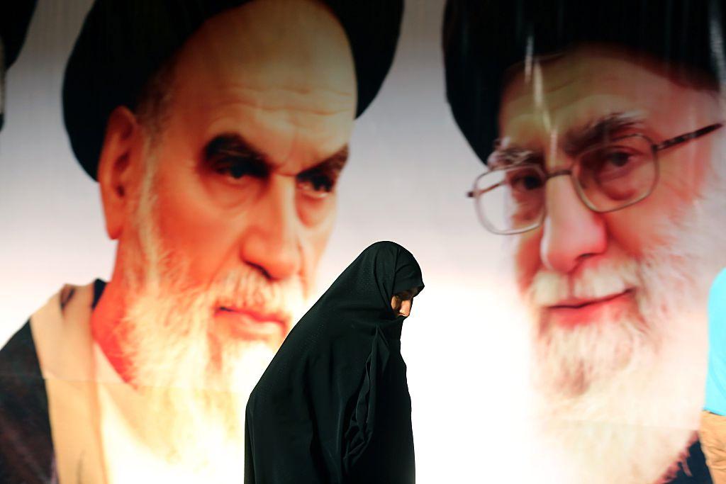 Woman walking through Tehran, Iran