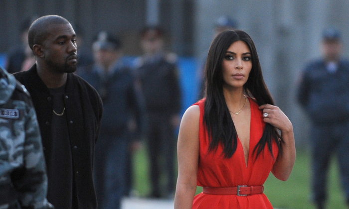 US reality TV star Kim Kardashian (C) and her rapper husband Kanye West (3rdL) visit the genocide memorial, which commemorates the 1915 mass killing of Armenians in the Ottoman Empire, in Yerevan on April 10, 2015. (KAREN MINASYAN/AFP/Getty Images)
