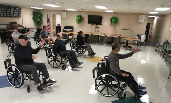Veterans in Murfreesboro, Tenn., enjoy a wheelchair tai chi class. Other alternative health programs now commonly offered at VA hospitals in the United States include yoga, mindfulness training, and art therapy. (Blake Farmer/Nashville Public Radio)