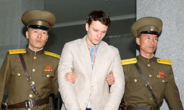 Otto Frederick Warmbier (C), a University of Virginia student who was detained in North Korea since early January, is taken to North Korea's top court in Pyongyang, North Korea, in this photo released by Kyodo March 16, 2016.        (Reuters/Kyodo/File Photo)