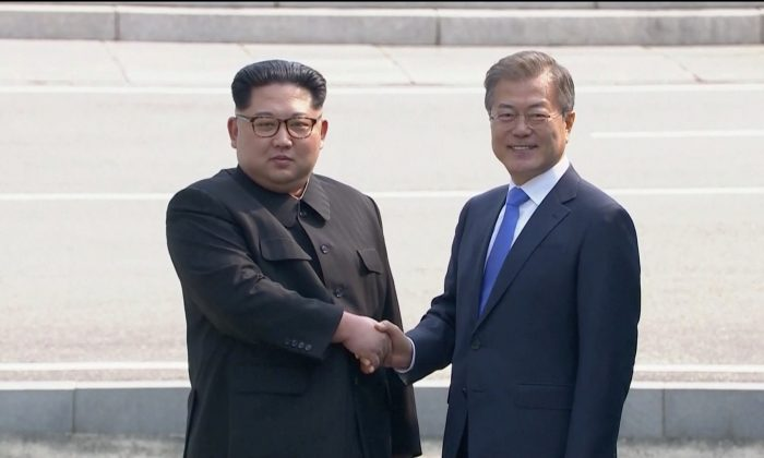 North Korean leader Kim Jong Un shakes hands with South Korean President Moon Jae-in as both of them arrive for the inter-Korean summit at the truce village of Panmunjom, in this still frame taken from video, South Korea April 27, 2018. (Reuters TV)
