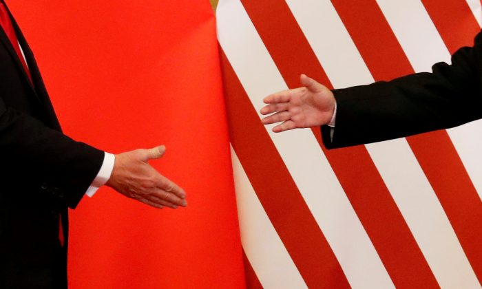 U.S. President Donald Trump and Chinese leader Xi Jinping about to shake hands at the Great Hall of the People in Beijing, China, on November 9, 2017. (Damir Sagolj/File Photo/Reuters)