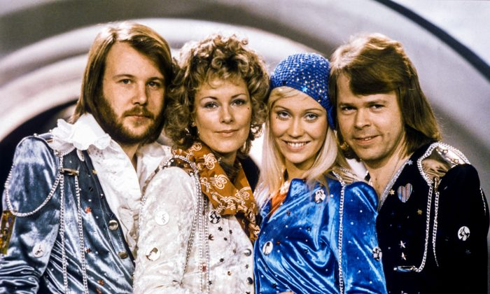 """Swedish pop group Abba: Benny Andersson, Anni-Frid Lyngstad, Agnetha Faltskog and Bjorn Ulvaeus pose after winning the Swedish branch of the Eurovision Song Contest with their song """"Waterloo"""", on Feb. 9, 1974. (Olle Lindeborg/TT News Agency/via REUTERS)"""