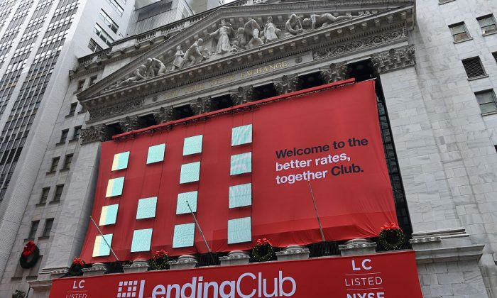 Lending Club banners hang on the facade of the New York Stock Exchange for it's IPO in New York, on Dec. 11, 2014. Lending Club's stock plunged after FTC's announcement on Apr. 25. (DON EMMERT/AFP/Getty Images)