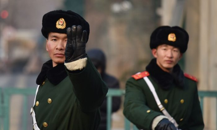 Chinese paramilitary police officers stand guard outside a foreign embassy in Beijing on Dec. 28, 2017. (Photo credit should read GREG BAKER/AFP/Getty Images)