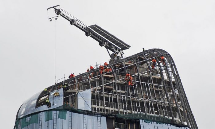 Construction work continues on the roof of One Blackfriars, also known as the Vase, in London, on March 15, 2018. Construction has fallen to the lowest level since 2008. (Justin Tallis/AFP/Getty Images)