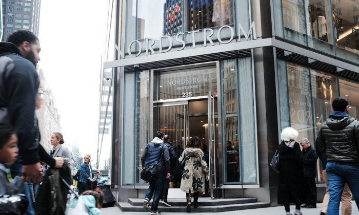 People walk by the newly opened Nordstrom men's store, the company's first Manhattan location, on April 12 in New York. (Spencer Platt/Getty Images)
