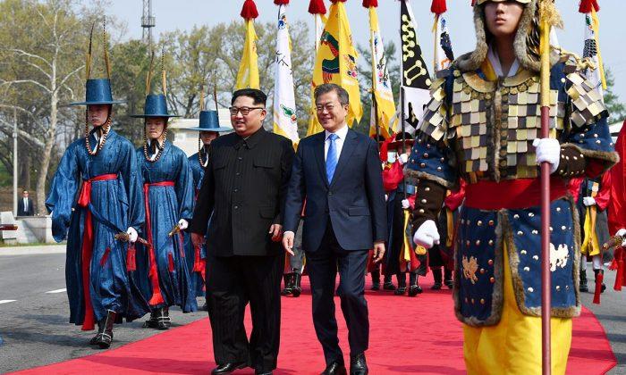 South Korean President Moon Jae-in and North Korean leader Kim Jong Un meet in the truce village of Panmunjom. (Korea Summit Press Pool/Pool via Reuters)
