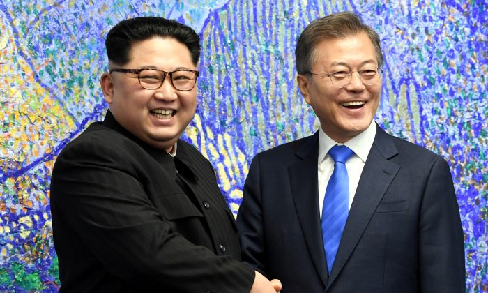 South Korean President Moon Jae-in shakes hands with North Korean leader Kim Jong Un during their meeting at the Peace House. (Korea Summit Press Pool/Pool via Reuters)