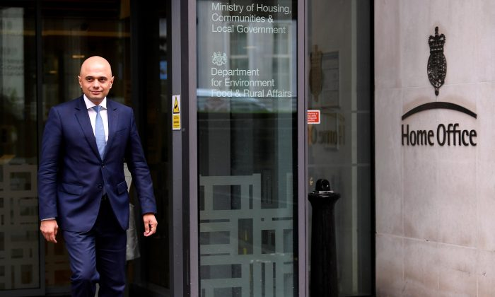 Sajid Javid walks out of the Home Office after being named as Britain's Home Secretary, in London, April 30, 2018. (Reuters/Toby Melville)