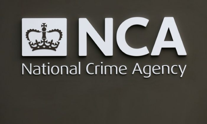 A sign is seen outside the National Crime Agency (NCA) headquarters in London Oct. 7, 2013.  (REUTERS/Stefan Wermuth)