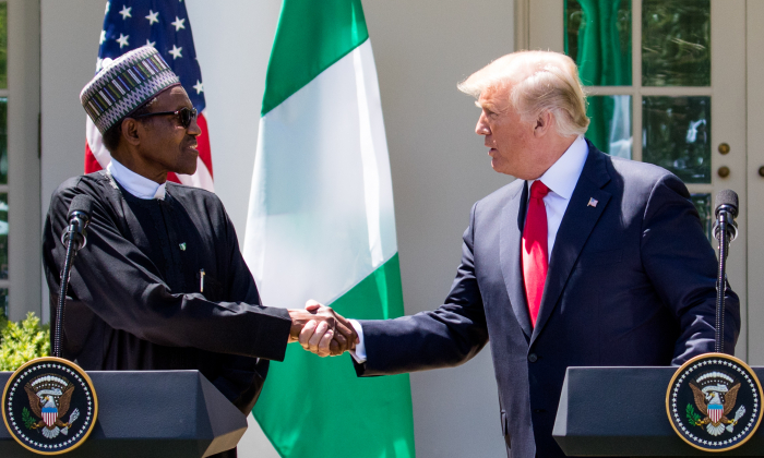 President Donald Trump hosts a joint press conference with President Muhammadu Buhari of the Federal Republic of Nigeria in the Rose Garden of the White House in Washington on April 30, 2018. (Samira Bouaou/The Epoch Times)